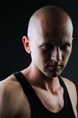 undershirt: Portrait of a  man on black background Stock Photo