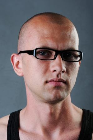 Bald man with glasses in his twenties Stock Photo - 13822632