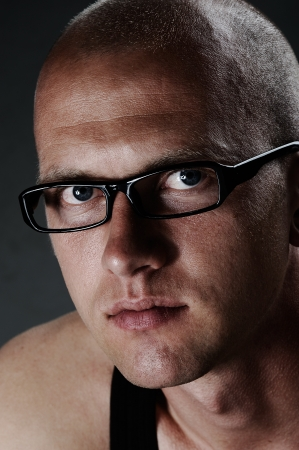 Close up portrait of a man with glasses photo