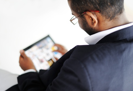 Handsome African American man with tablet computer Stock Photo - 13827187
