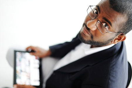 Handsome African American man with tablet computer photo