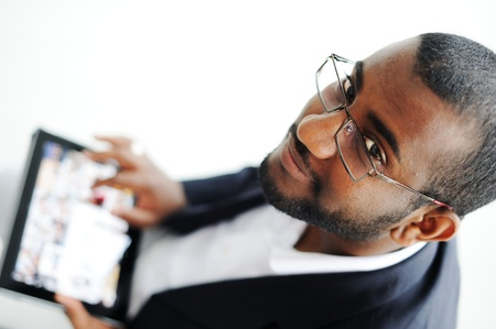 touch pad: Handsome African American man with tablet computer Stock Photo