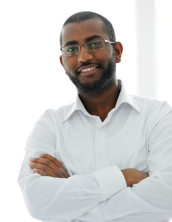 Portrait of American African business man smiling with arms crossed over white background photo