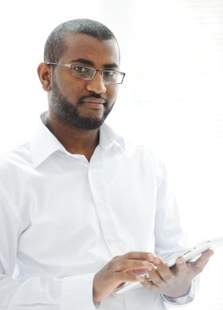 African American Arabic person with pc tablet photo