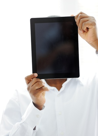 African man holding tablet ready for your message photo