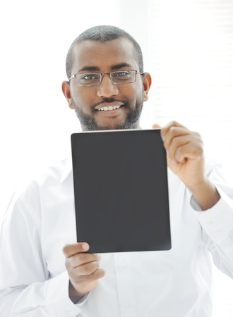 African man holding tablet ready for your message Stock Photo - 13827924
