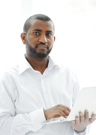 African American businessman with a laptop Stock Photo - 13827885