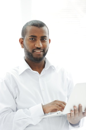 African American businessman with a laptop Stock Photo - 13827886