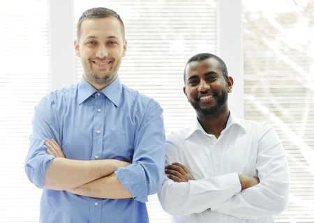 African American and Caucasian business man together photo