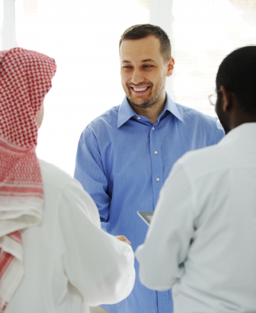 Business people different cultures and races talking photo
