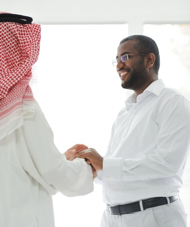 Arabic and African American business men photo