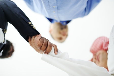 middle east: Closeup of business people shaking hands over a deal somewhere in the Middle east Stock Photo