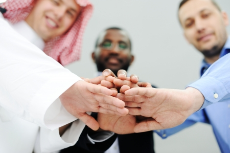 Business team overlapping hands Stock Photo - 13827698