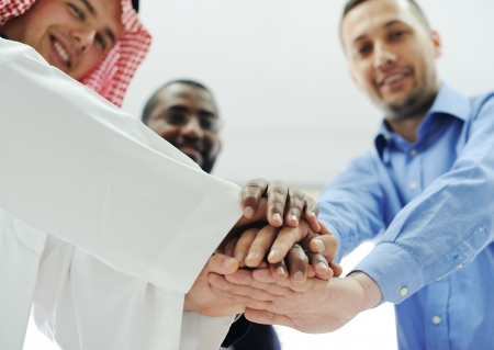 Business team overlapping hands Stock Photo - 13827615