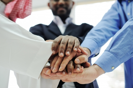 Business team overlapping hands Stock Photo - 13826973