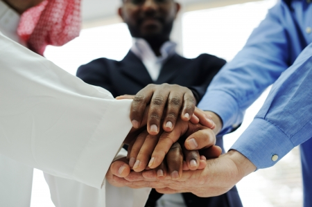 Business team overlapping hands Stock Photo - 13826955