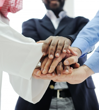 Business team overlapping hands Stock Photo - 13827680