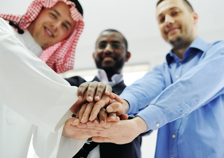 uae: Business team overlapping hands