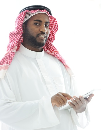 Arabic business man with tablet at office photo