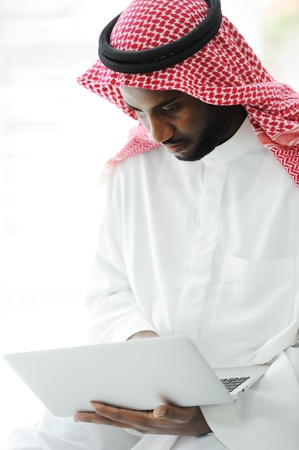 Black Arabic man working on laptop Stock Photo - 13827578