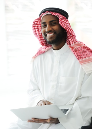 Black Arabic man working on laptop Stock Photo - 13827682