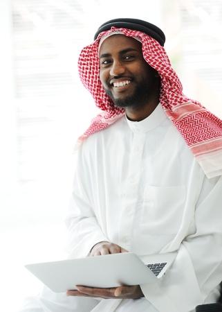 Black Arabic man working on laptop Stock Photo - 13827682