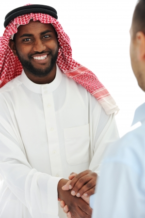 Arabic and european american business man making a deal and handshaking photo