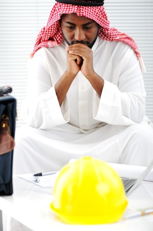 middle east crisis: Arabic engineer having a concern about the plans Stock Photo