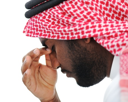 Arabic businessman stressed in crisis concerns Stock Photo - 13827630