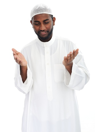 Black arabic man praying Stock Photo