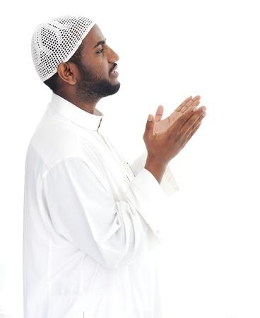 african worship: Black arabic man praying Stock Photo