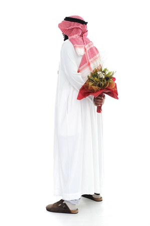 hides: Middle eastern man hides behind a roses for his wife Stock Photo