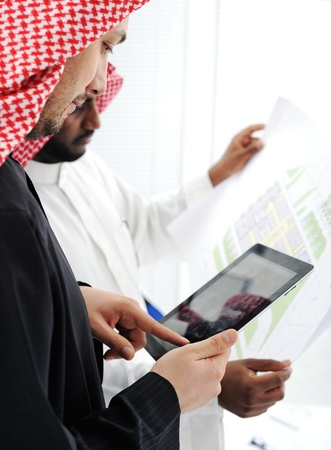 the gulf: Business people planning work in office working on tablet computer