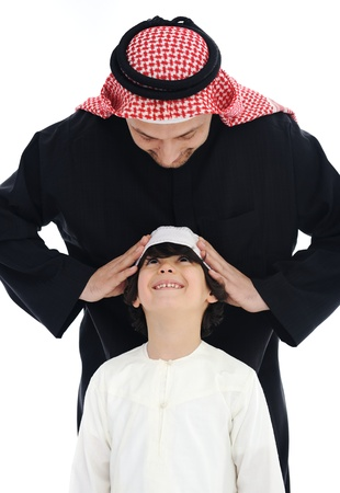 Arabic Muslim father and son standing together Stock Photo - 13827660