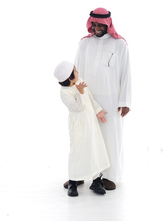 arab people: Arabic Muslim father and son standing together