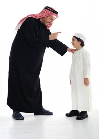 middle eastern families: Arabic Muslim father and son standing together
