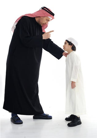 Arabic Muslim father and son standing together photo