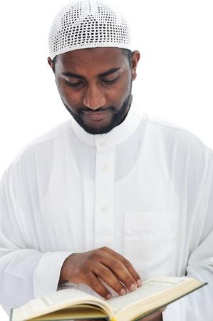 Muslim African man reading the Qoran Stock Photo - 13827746