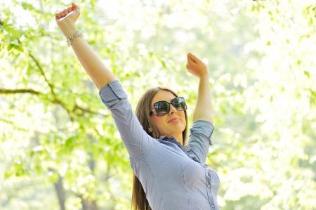 Good looking woman having fun in nature Stock Photo - 13824065