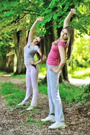excercise: Two female friends doing excercise in nature