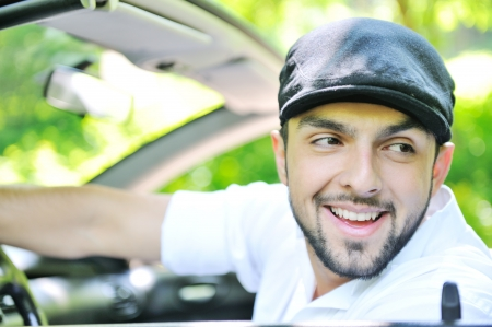 Handsome guy in a car smiling photo