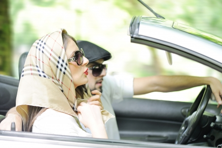 headscarf: Young lovers enjoying nature in a car