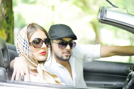 Adult guy driving a car with his female friend Stock Photo - 13826143