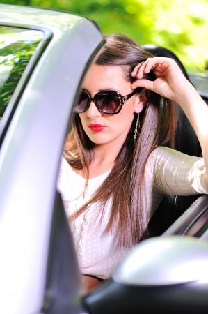 Beautiful woman driving sports car Stock Photo - 13823327