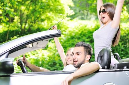 Three friends in a sports car photo