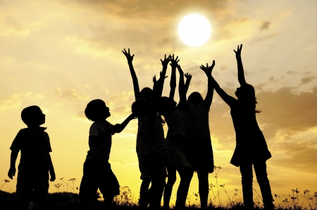 kid friendly: Children and the sun at sunset Stock Photo