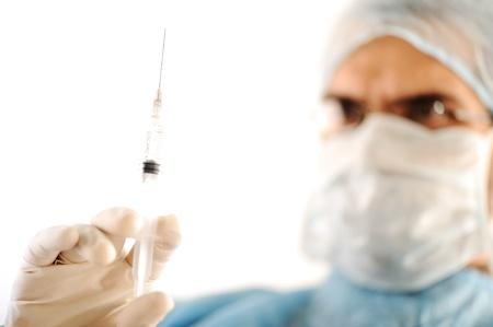 intravenous: Surgeon holding injection vaccine