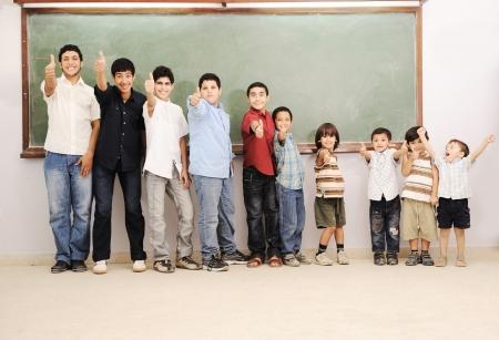 elementary age boy: Children at school classroom