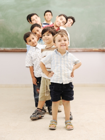 schoolboys: Children at school classroom