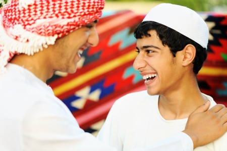 Two brothers, two arabic young people photo